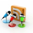 Microphones in front of a RSS feed icon.